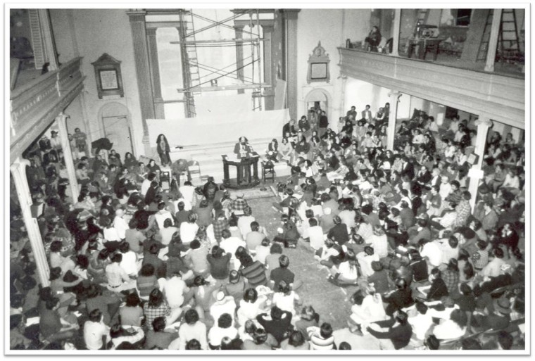 Allen Ginsberg reads in the Sanctuary, ca. 1976 (Maureen Owen sits on the steps to his right). Courtesy St. Mark's Historic Landmark Fund